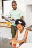 Concentrated father reading newspaper Royalty Free Stock Image