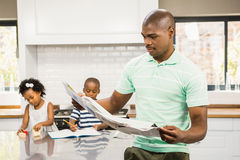 Concentrated father reading paper Royalty Free Stock Images