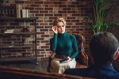 Concentrated female consultor carefully listening Royalty Free Stock Photography