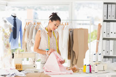 Concentrated female fashion designer at work Stock Images