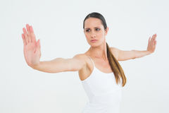 Concentrated fit young woman doing pilate exercises Stock Photos