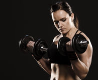 Concentrated fitness woman doing Royalty Free Stock Photos
