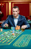 Concentrated gambler playing roulette at the casino Royalty Free Stock Photography