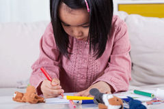 Concentrated girl drawing a picture Stock Image