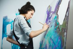 Concentrated girl focused on creative art-making process in art therapy. Concept. Form of psychotherapy that uses art media as its primary mode of communication Royalty Free Stock Photography