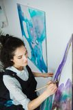 Concentrated girl focused on creative art-making process in art therapy. Concept. Form of psychotherapy that uses art media as its primary mode of communication Royalty Free Stock Images