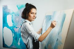 Concentrated girl focused on creative art-making process in art therapy Stock Photo