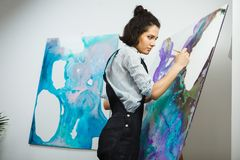 Concentrated girl focused on creative art-making process in art therapy. Concept. Form of psychotherapy that uses art media as its primary mode of communication Stock Images