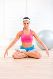 Concentrated girl practising yoga exercises Stock Image
