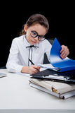 Concentrated girl working with documents at workplace Stock Images
