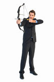 Concentrated handsome businessman practicing archery Stock Photos