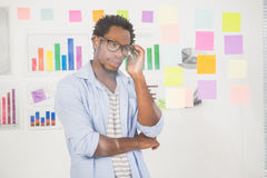 Concentrated handsome casual businessman looking at post-it Stock Photos