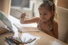 Concentrated on her homework stock image