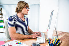 Concentrated hipster businessman using his computer Royalty Free Stock Photo