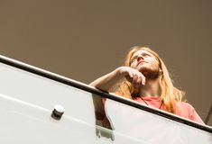 Concentrated Hipster on a Footbridge. Of Hong Kong Island Royalty Free Stock Photo