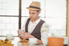 Concentrated hipster using smartphone Stock Photos