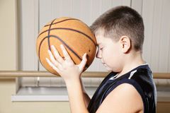Concentrated kid before throwing ball Stock Photo