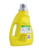 Concentrated laundry detergent. Yellow bottle of 2X concentrated laundry detergent on white background Royalty Free Stock Photos