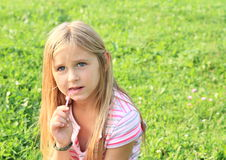 Concentrated little girl Stock Images