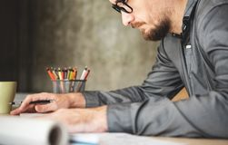Concentrated Male Architect Designer working. stock images