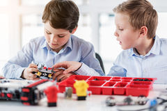 Concentrated male children keeping lego stock photography