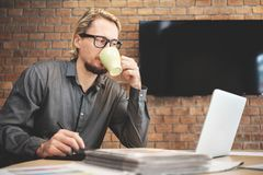 Concentrated Male Designer working. royalty free stock photography