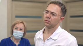 Concentrated male doctor in glasses controlling surgery. Close up shot. Professional shot in 4K resolution. 097. You can use it e.g. in your commercial video Royalty Free Stock Image