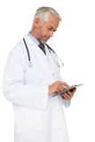 Concentrated male doctor using digital tablet Royalty Free Stock Images