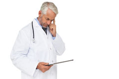 Concentrated male doctor using digital tablet Royalty Free Stock Photos