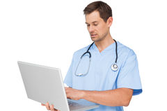 Concentrated male surgeon using laptop Royalty Free Stock Photo