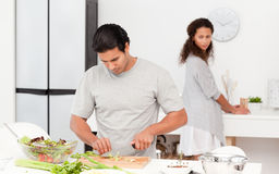 Concentrated man cutting vegetables Stock Photography