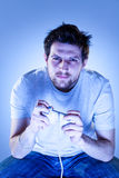 Concentrated Man with Gamepad Stock Photo