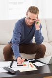 Concentrated man with glasses taking notes Royalty Free Stock Photos