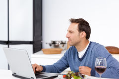 Concentrated man looking at his laptop Royalty Free Stock Image