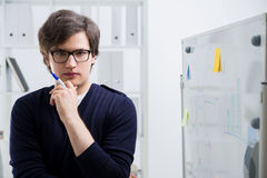 Concentrated man next to whiteboard Stock Photo