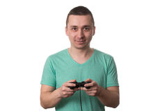 Concentrated Man Playing Video Games On A White Background Royalty Free Stock Image