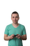 Concentrated Man Playing Video Games On A White Background Stock Photo