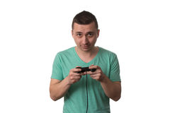 Concentrated Man Playing Video Games On A White Background Royalty Free Stock Photos