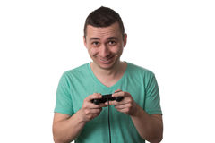 Concentrated Man Playing Video Games On A White Background Stock Photography