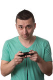 Concentrated Man Playing Video Games On A White Background Royalty Free Stock Images