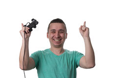 Concentrated Man Playing Video Games On A White Background Royalty Free Stock Photography