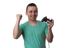 Concentrated Man Playing Video Games On A White Background Stock Photos