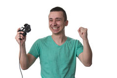 Concentrated Man Playing Video Games On A White Background Stock Images