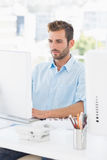 Concentrated man using computer in office Royalty Free Stock Images