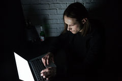 Concentrated man using laptop computer at home indoors Stock Image