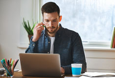 Concentrated man working on laptop Royalty Free Stock Images