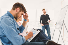 Concentrated man writing on paper Royalty Free Stock Photos