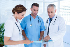 Concentrated medical colleagues analyzing file together Stock Photo