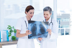 Concentrated medical colleagues examining x-ray together Royalty Free Stock Images
