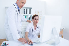 Concentrated medical colleagues working with computer Royalty Free Stock Images